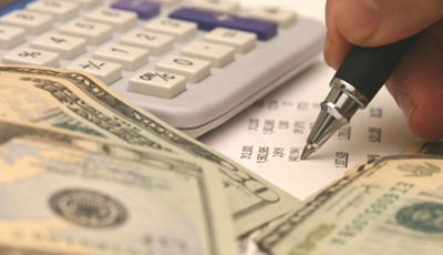 calculator, money and worksheet